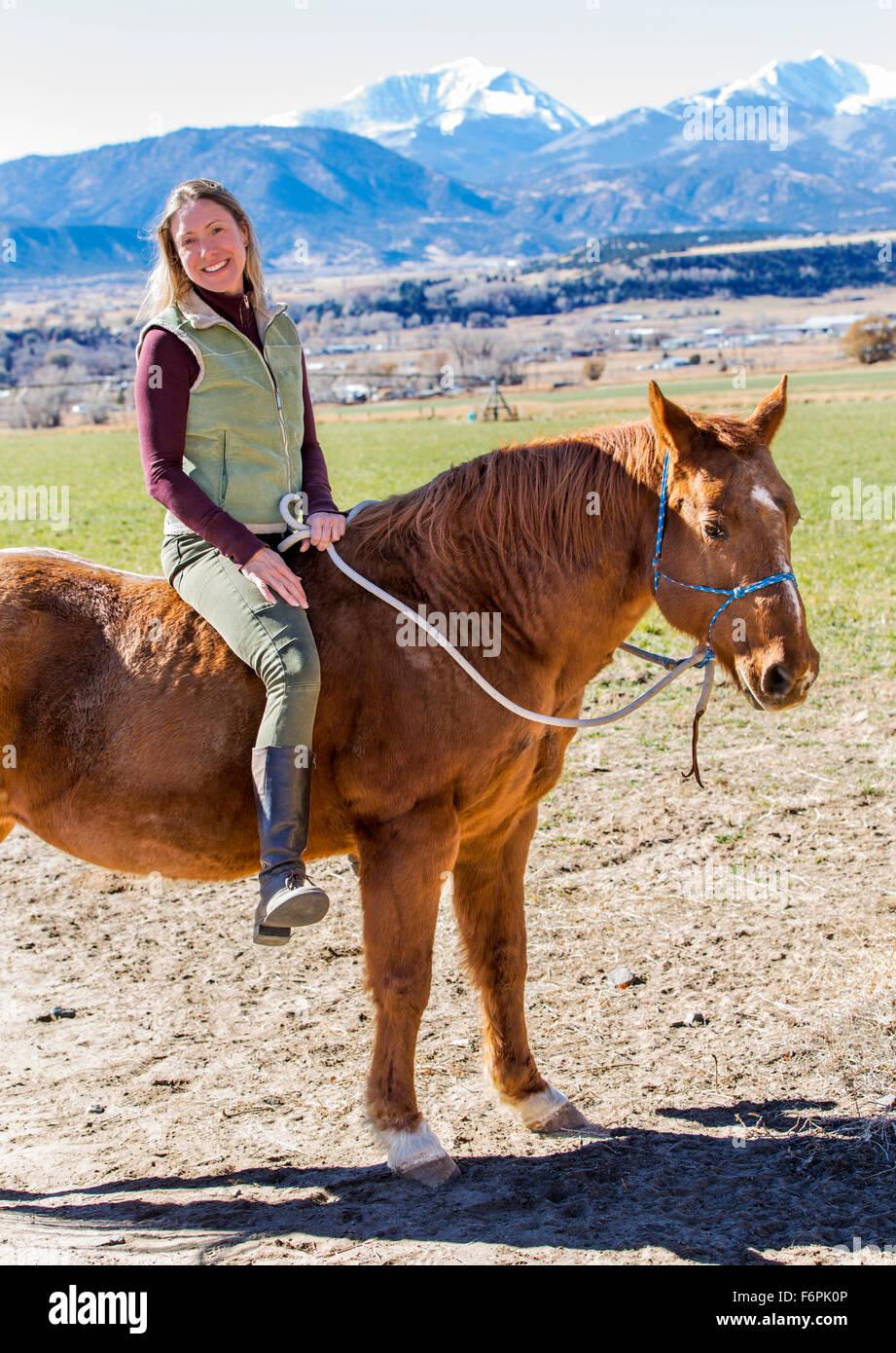 Woman Riding Horse Stock Photos & Woman Riding Horse Stock