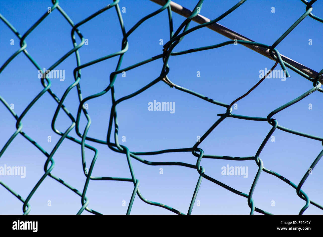 Wire Mesh Fence Hole Stock Photos & Wire Mesh Fence Hole Stock ...