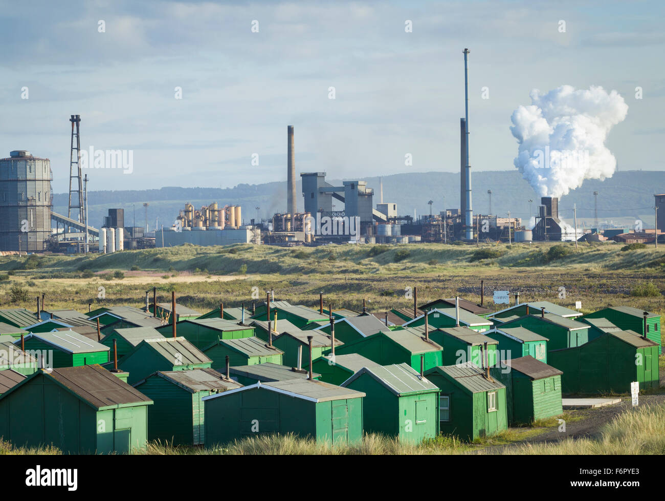 Fishermen`s huts at South Gare ( also known as Paddy`s Hole) with Redcar Steelworks in background. Redcar, England, - Stock Image