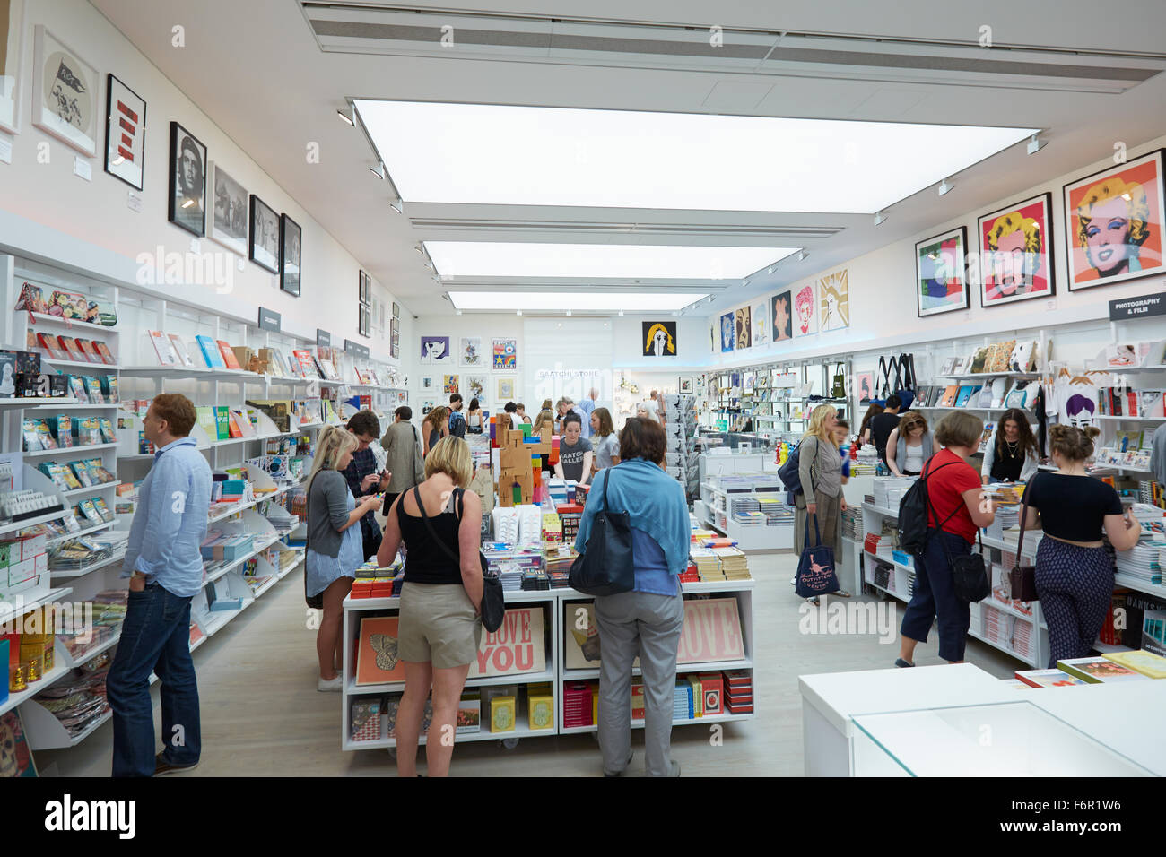 Visitors at the Saatchi Gallery book shop in London - Stock Image