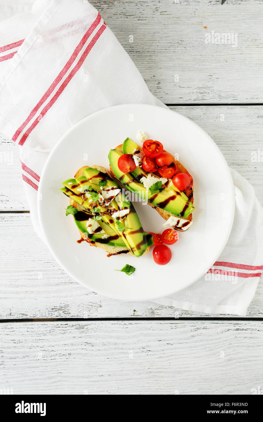 two sandwich with avocado and tomatoes, food top view - Stock Image