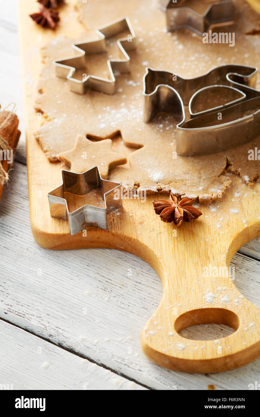 christmas cookies making, dough and cutters - Stock Image