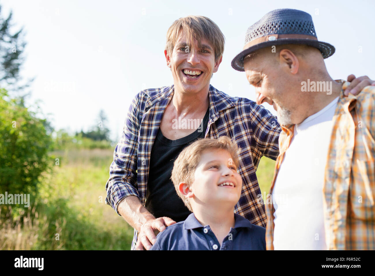 Portrait of happy multi-generation family outdoors - Stock Image