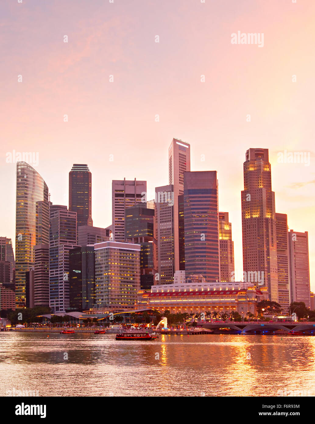 Colorful Singapore Downtown Core at sunset - Stock Image