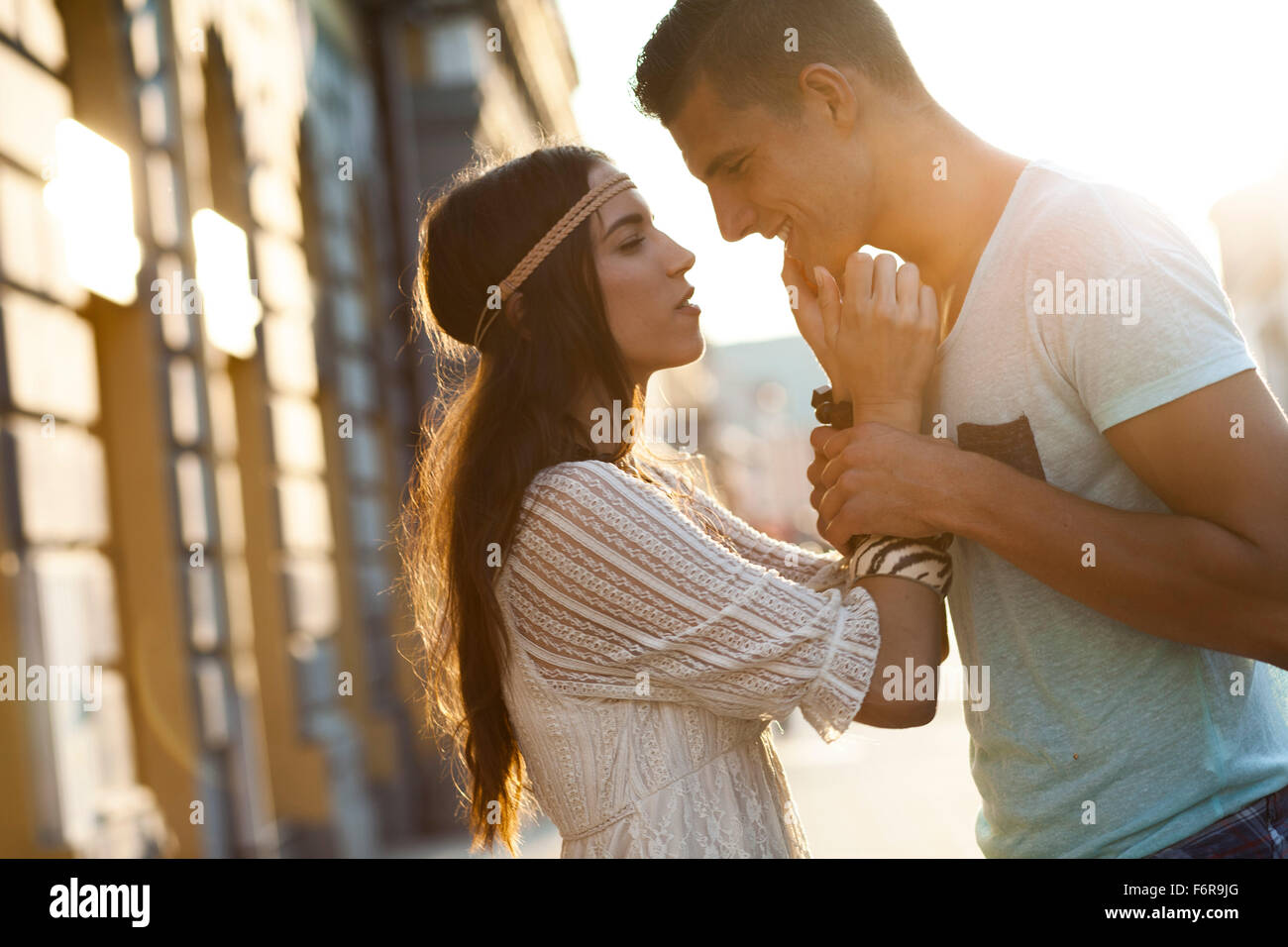 Young couple in hippie style fashion falling in love - Stock Image