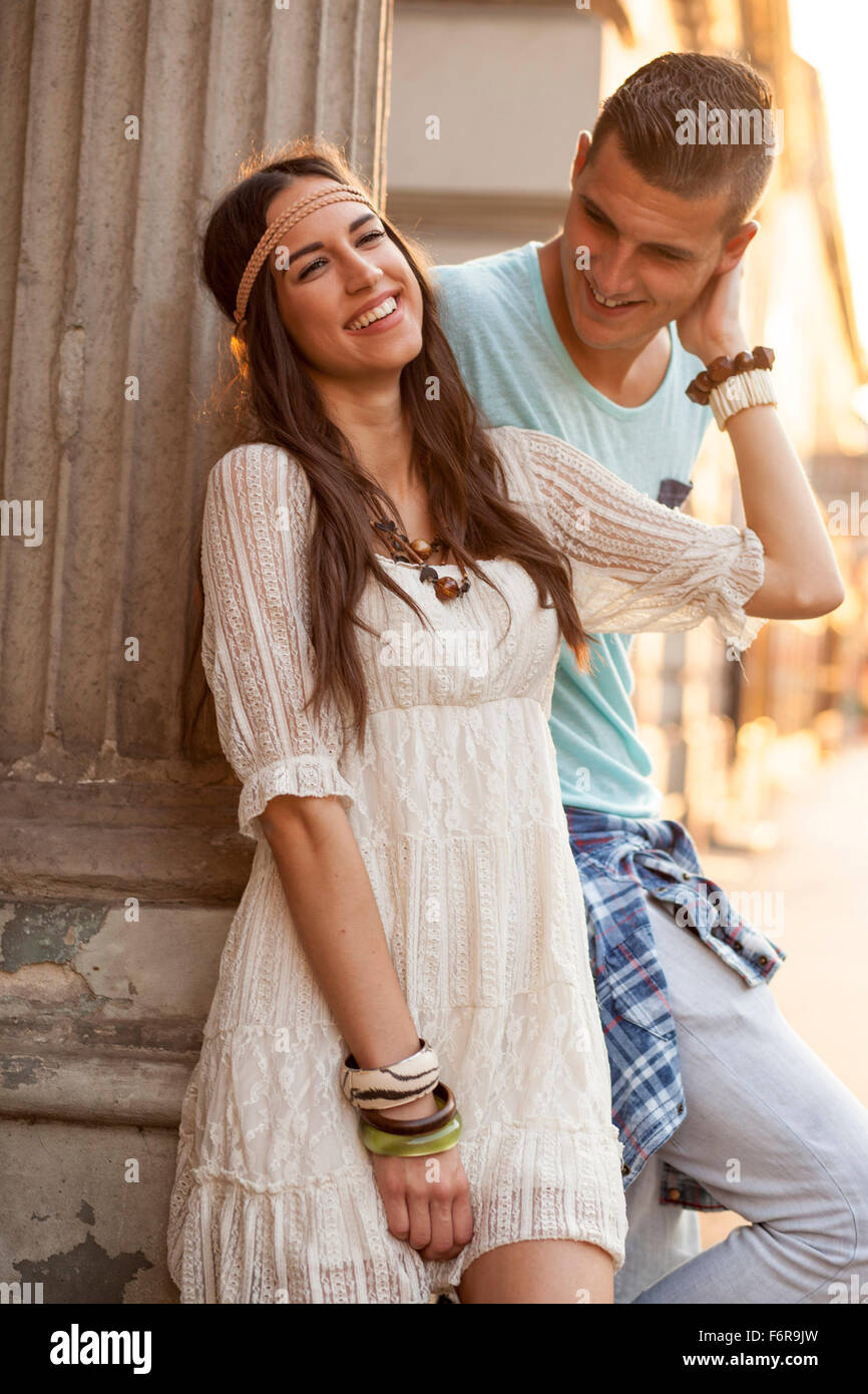 Young couple in hippie style fashion flirting - Stock Image