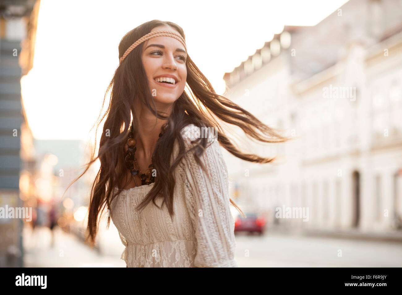 Young woman with tousled hair and headband - Stock Image