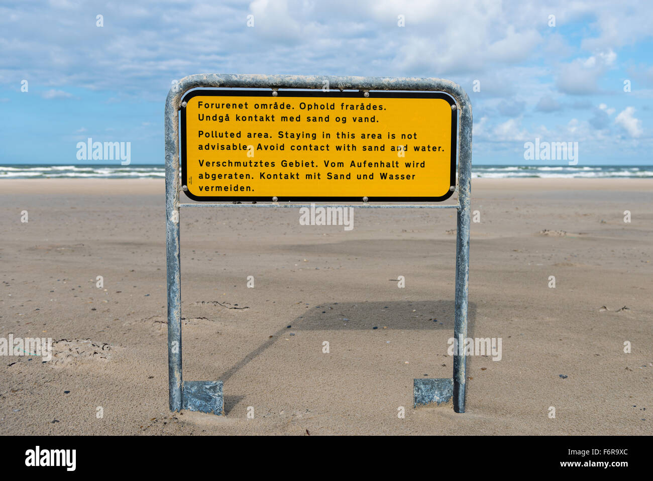 Warning sign, polluted area at Henne Mølle Å beach south, Oksböl, Region of Southern Denmark, Denmark - Stock Image