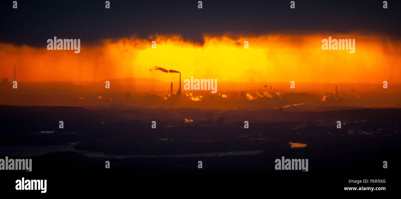 Marl Chemical Park after a rainstorm at sunset, industrial backdrop, silhouette of the chemical industrial plant, - Stock Image