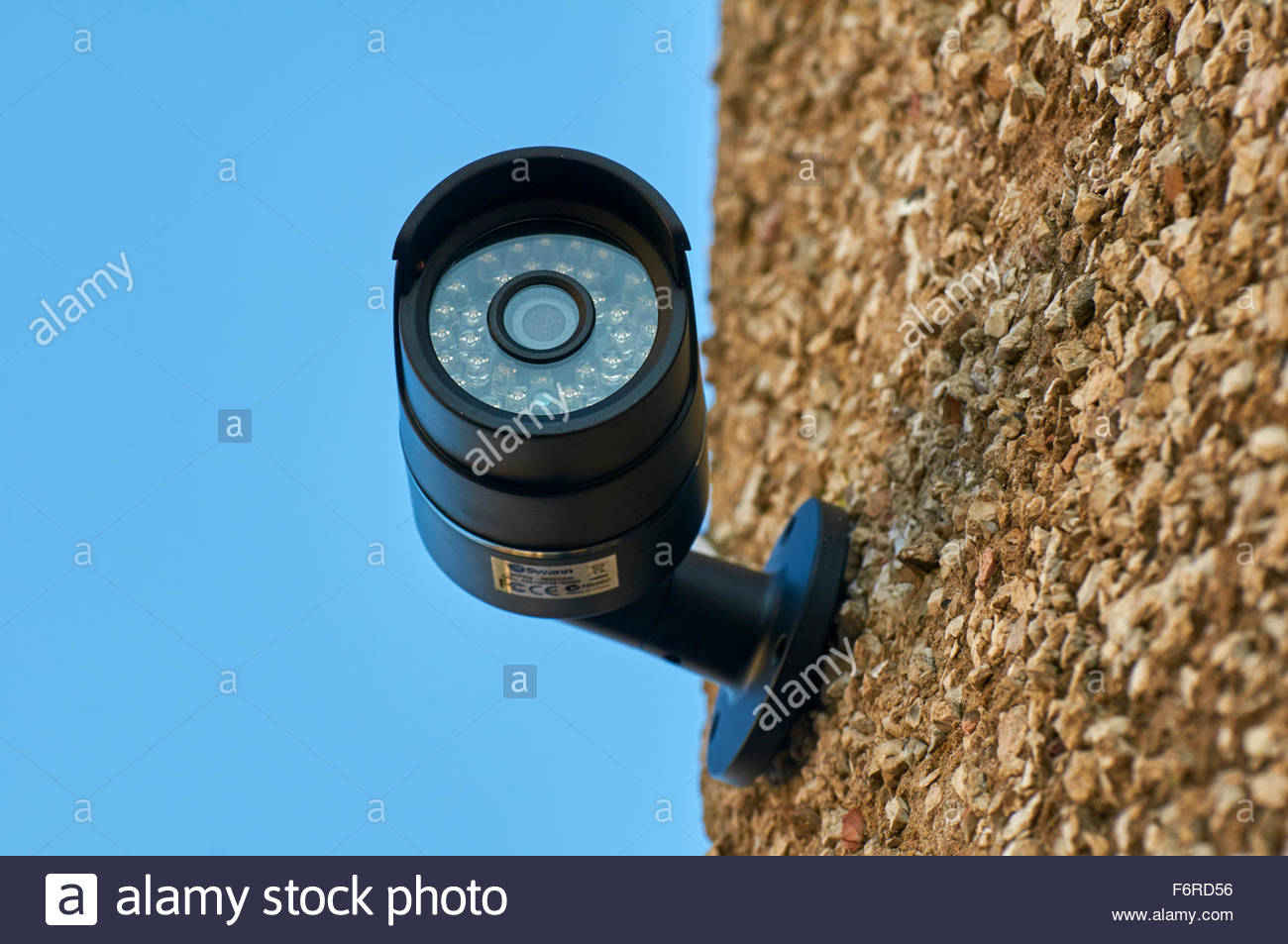 Close up of a wall mounted home security cctv surveillance monitoring camera system - Stock Image
