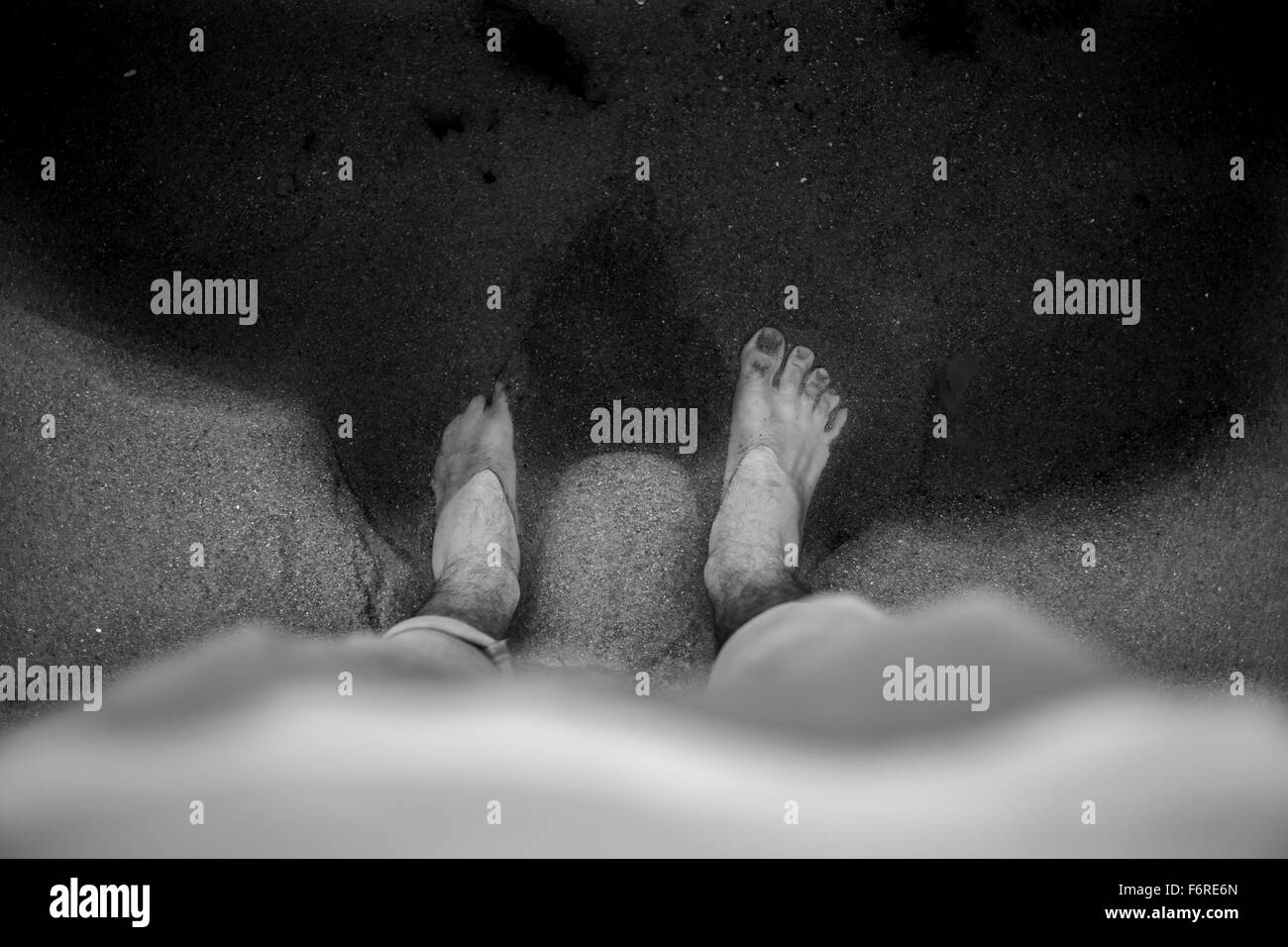 feet in water black and white - Stock Image