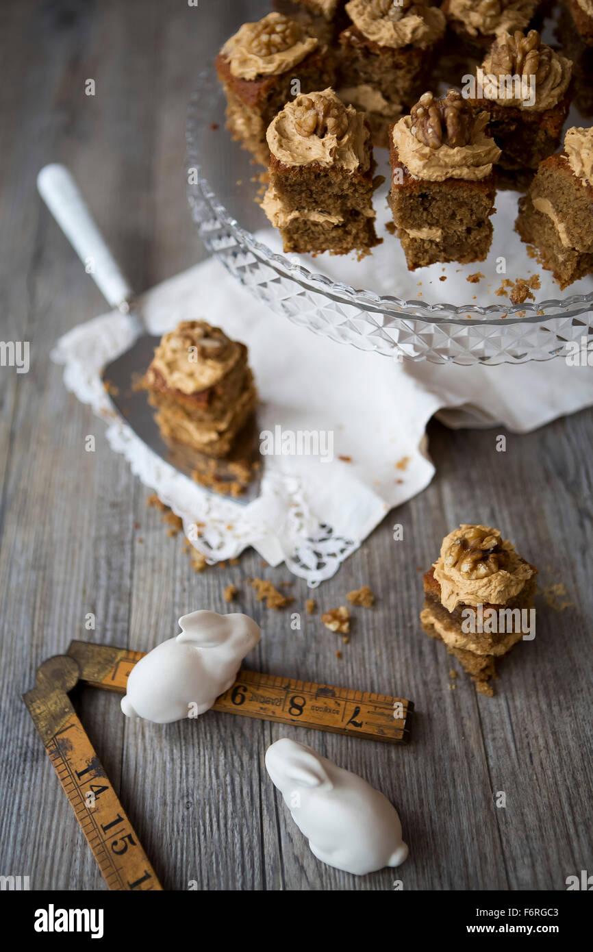 Walnut & Coffee Mini Cakes on Cake Stand - Stock Image