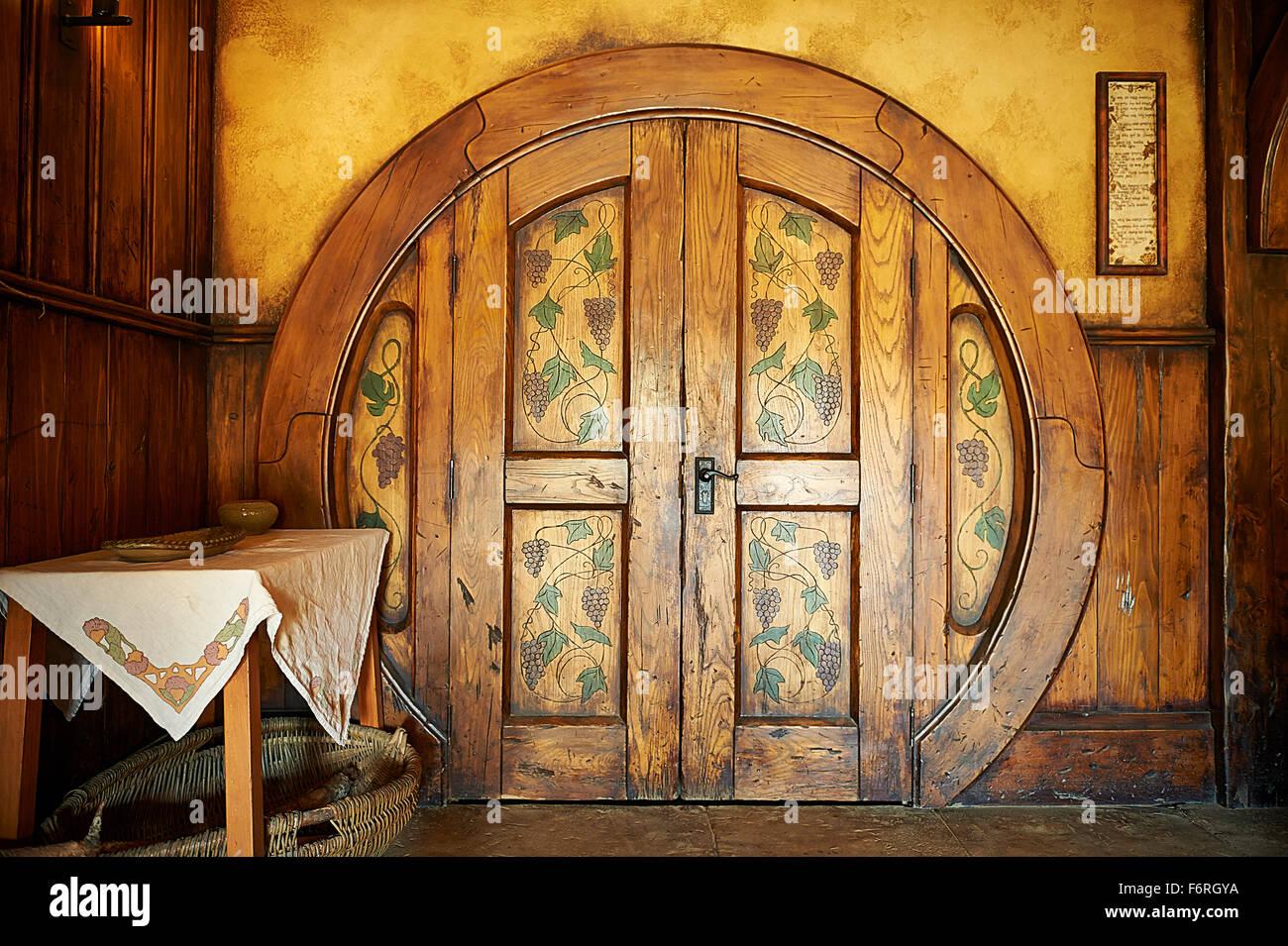 Inside The Green Dragon. Round door. Hobbiton New Zealand & Inside The Green Dragon. Round door. Hobbiton New Zealand Stock ...