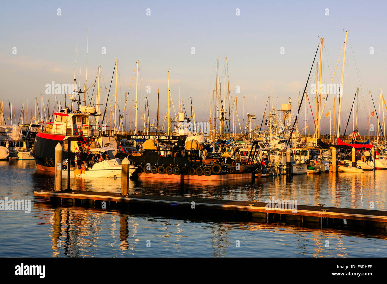 Fishing boats and pleasure craft all tied up in the Santa Barbara Marina and commercial harbor in California - Stock Image