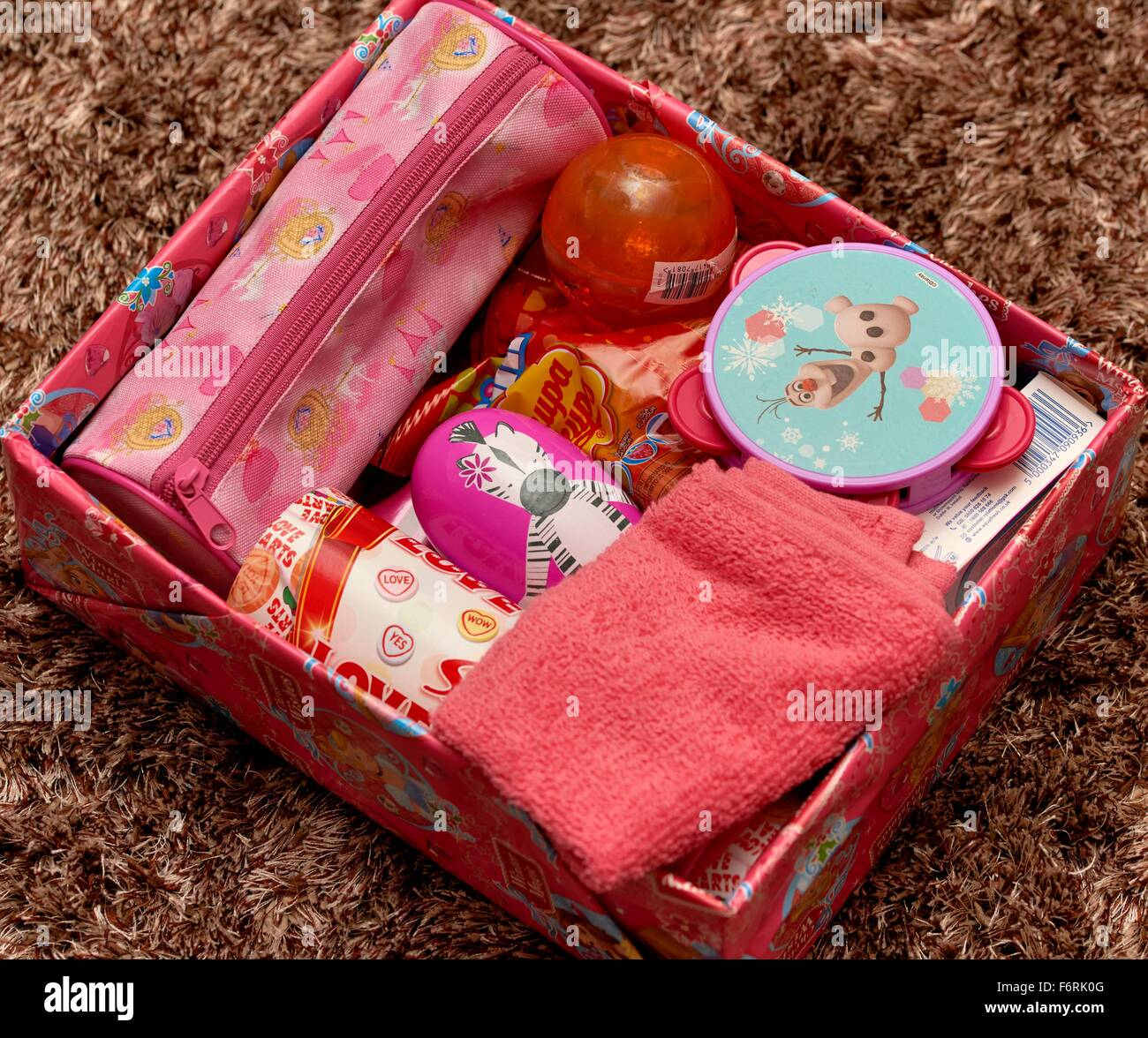 Christmas Shoe Box Appeal.A Charity Appeal Shoe Box With Presents For A Girl Stock