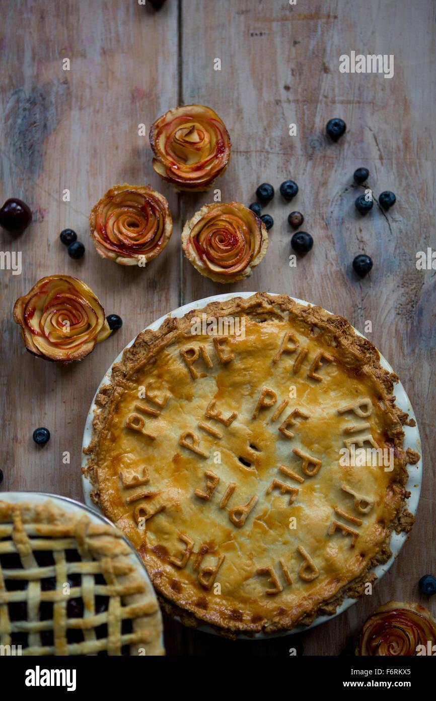 Trio of Pies, Fruit Pie, Lattice Pie and Apple Petal Single Pies - Stock Image