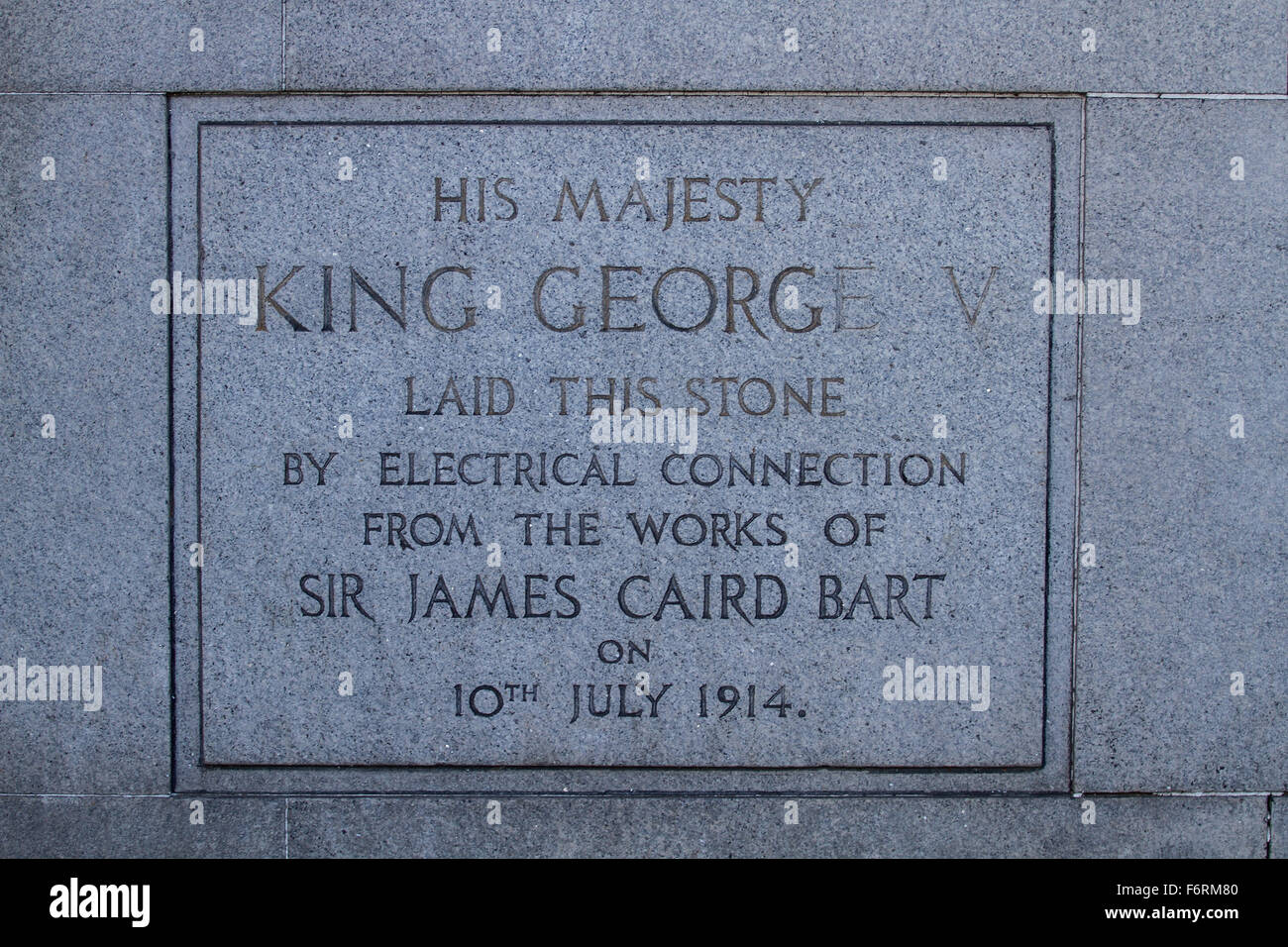 King George V laid this engraved plaque in 1914 to commemorate the works of Sir James Caird Bart in Dundee, UK - Stock Image