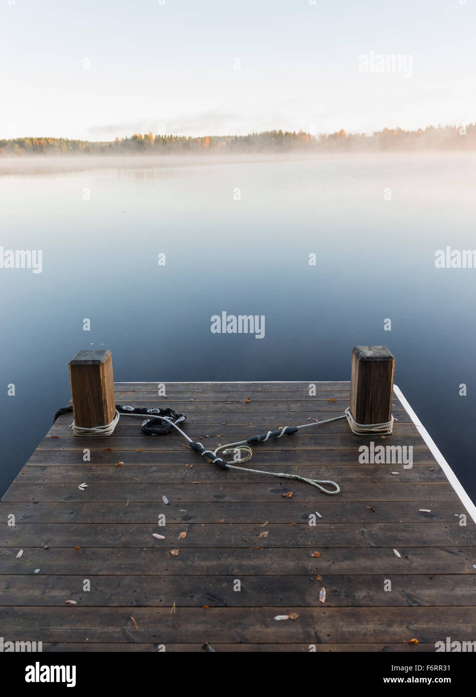 Jetty and misty lake - Stock Image