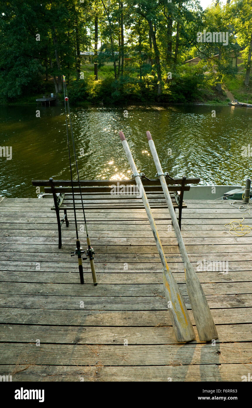 Old Wooden Oars And Fishing Rods On Dock Stock Photo 90262875 Alamy