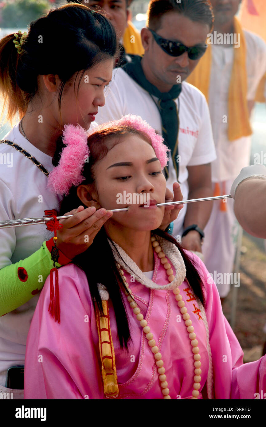 Thailand Phuket Festivals A Mah Jong going through the ritual of face piercing  Adrian Baker - Stock Image