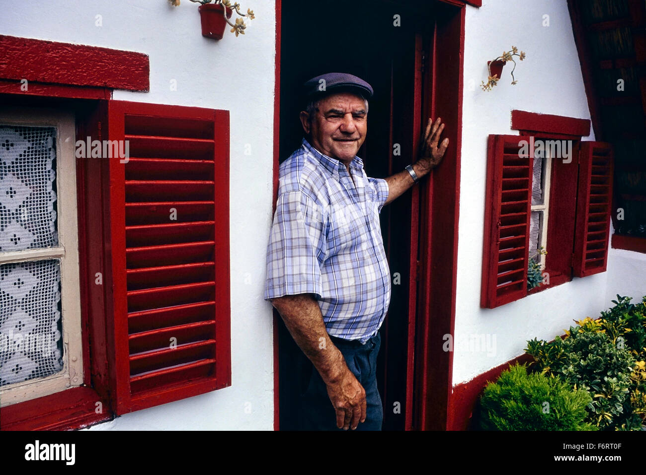 A local man posing at his front door. Santana. Madeira. Portugal - Stock Image