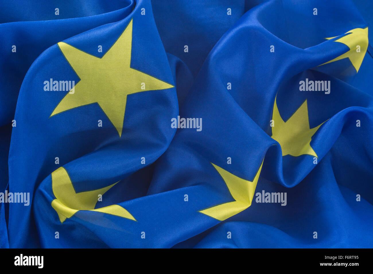 Ruffled yellow stars of the EU / European Union flag symbolizing disharmony. - Stock Image