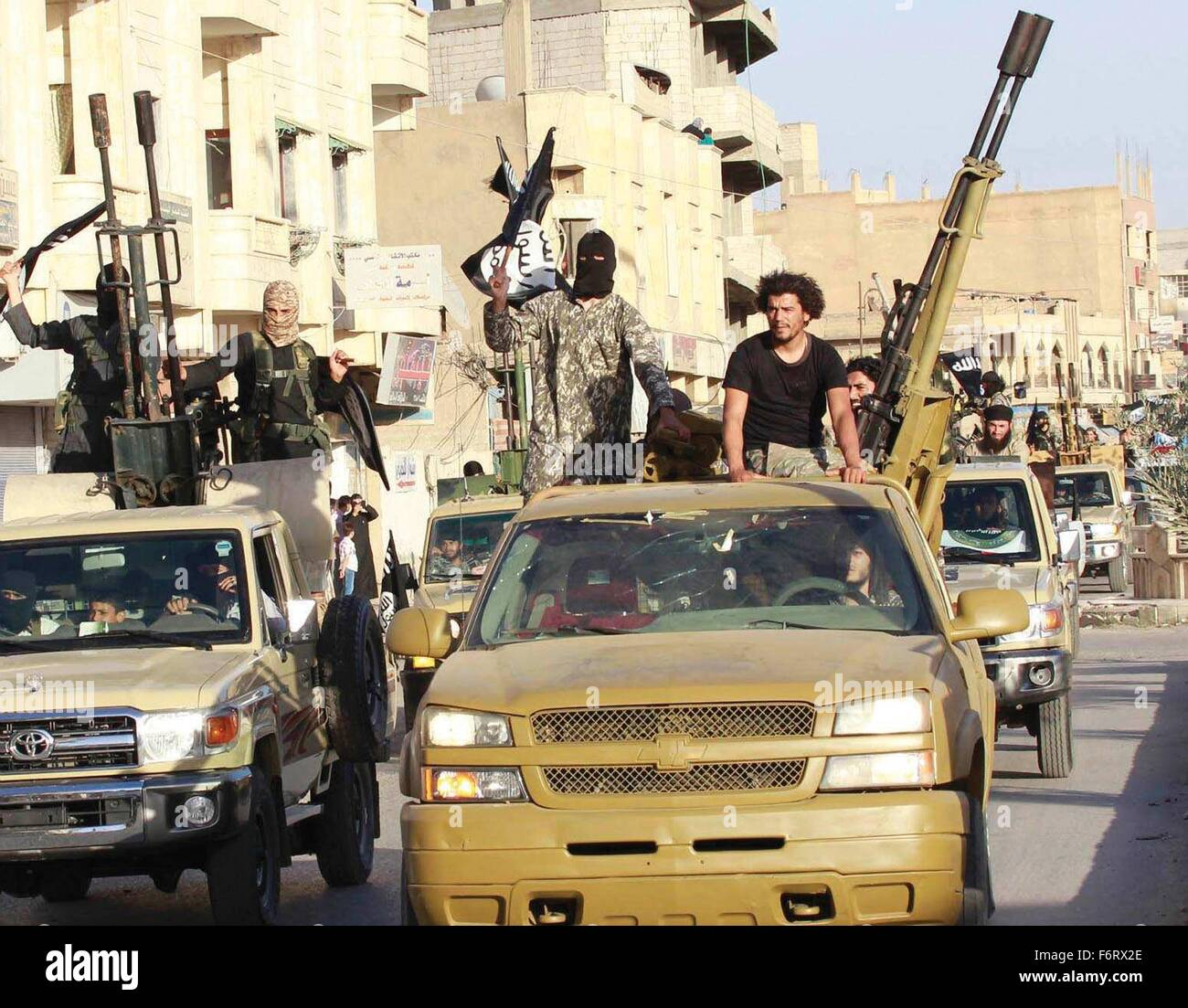 Islamic State of Iraq and the Levant propaganda photo showing masked militants parading June 30, 2014 in Northern Stock Photo