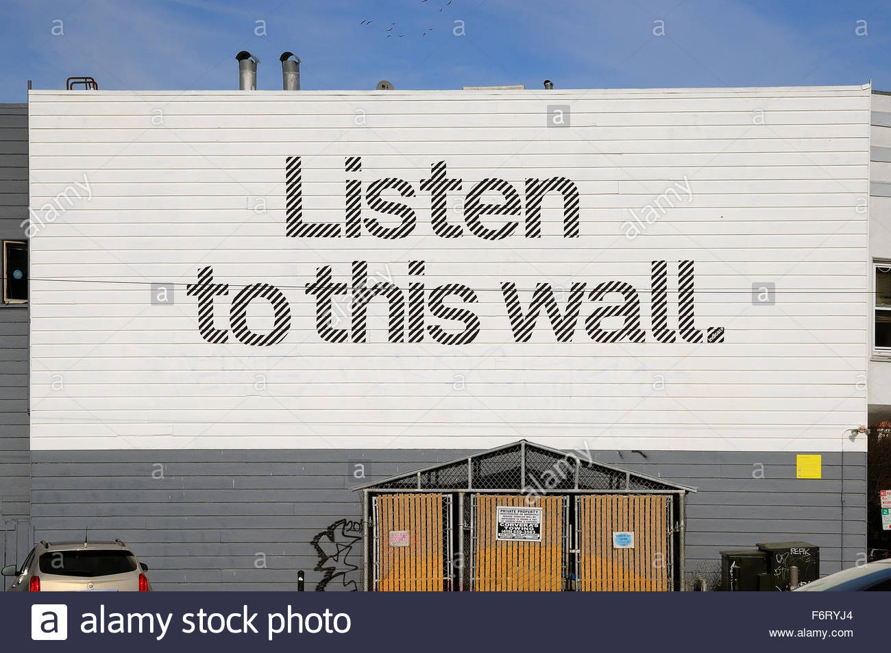 Listen to this wall. Graffiti message on a wall in Haight-Ashbury, San Francisco - Stock Image