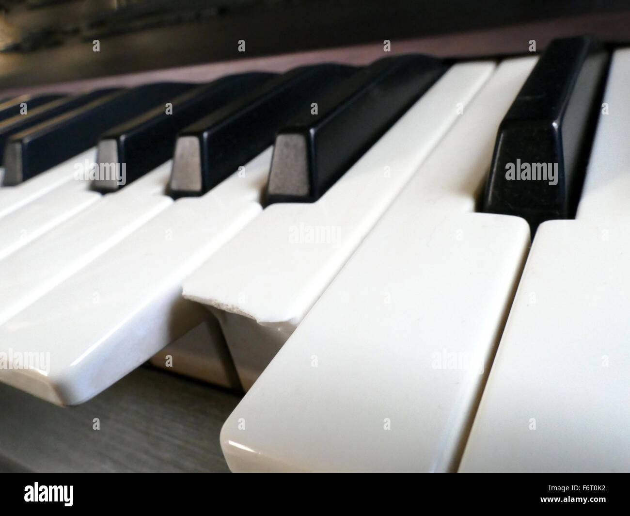 Closeup of broken key of Electronic Piano synthesizer Keyboard - Stock Image