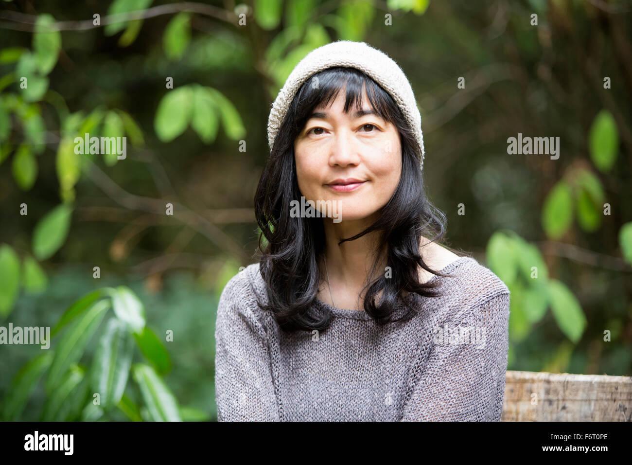Japanese woman sitting in garden Stock Photo