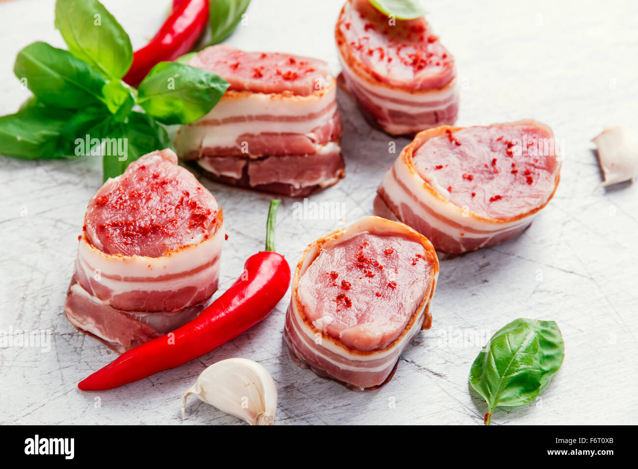 raw Pork tenderloin medallions with bacon wrapped - Stock Image