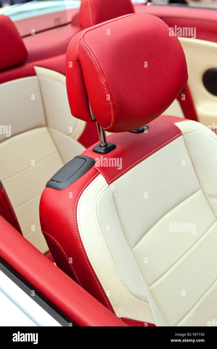 Red And White Leather Seats In A Convertible Car Stock Photo