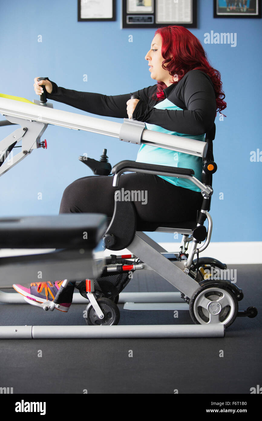 Disabled woman doing physical therapy Stock Photo