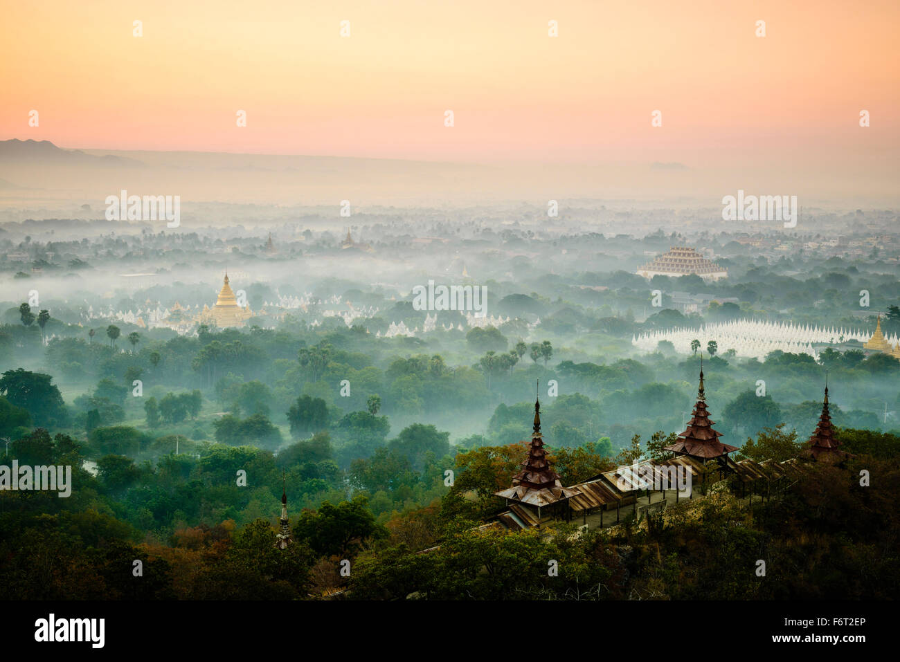 Aerial view of towers in misty landscape Stock Photo