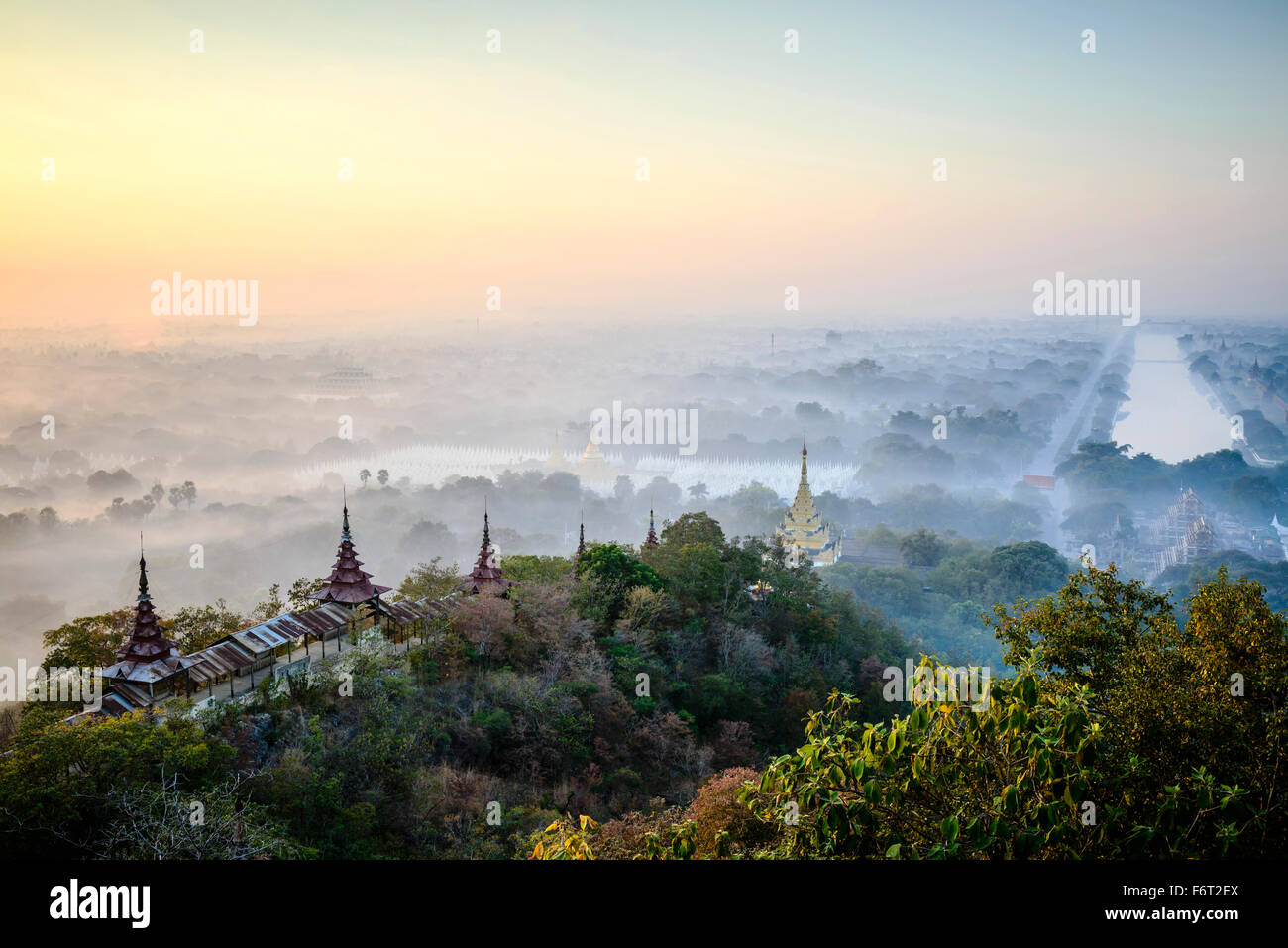Aerial view of towers in misty landscape - Stock Image