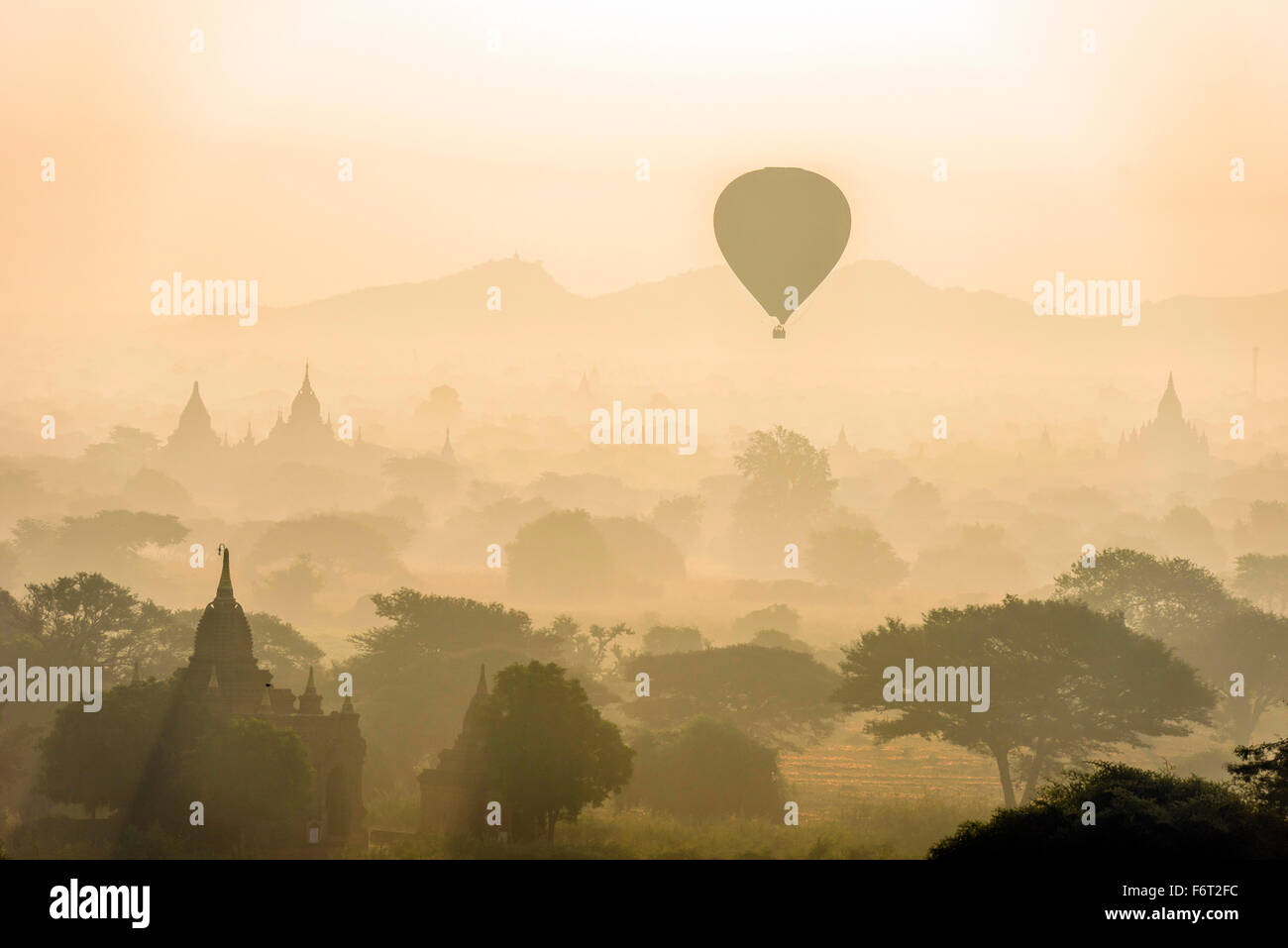 Aerial view of hot air balloons flying over towers - Stock Image