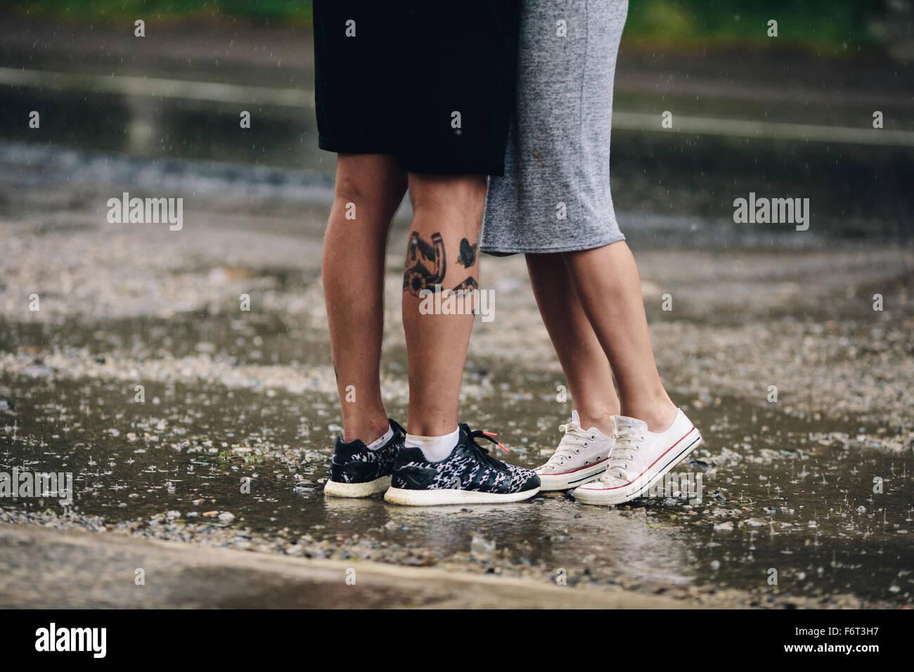 couple on the background of wet asphalt - Stock Image