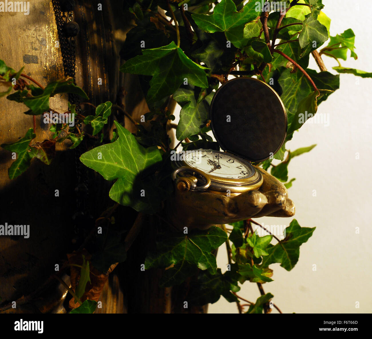 statue,face,sculpture,ivy leaves,time,watch,buddism,eaastern religion,religuos icon, - Stock Image