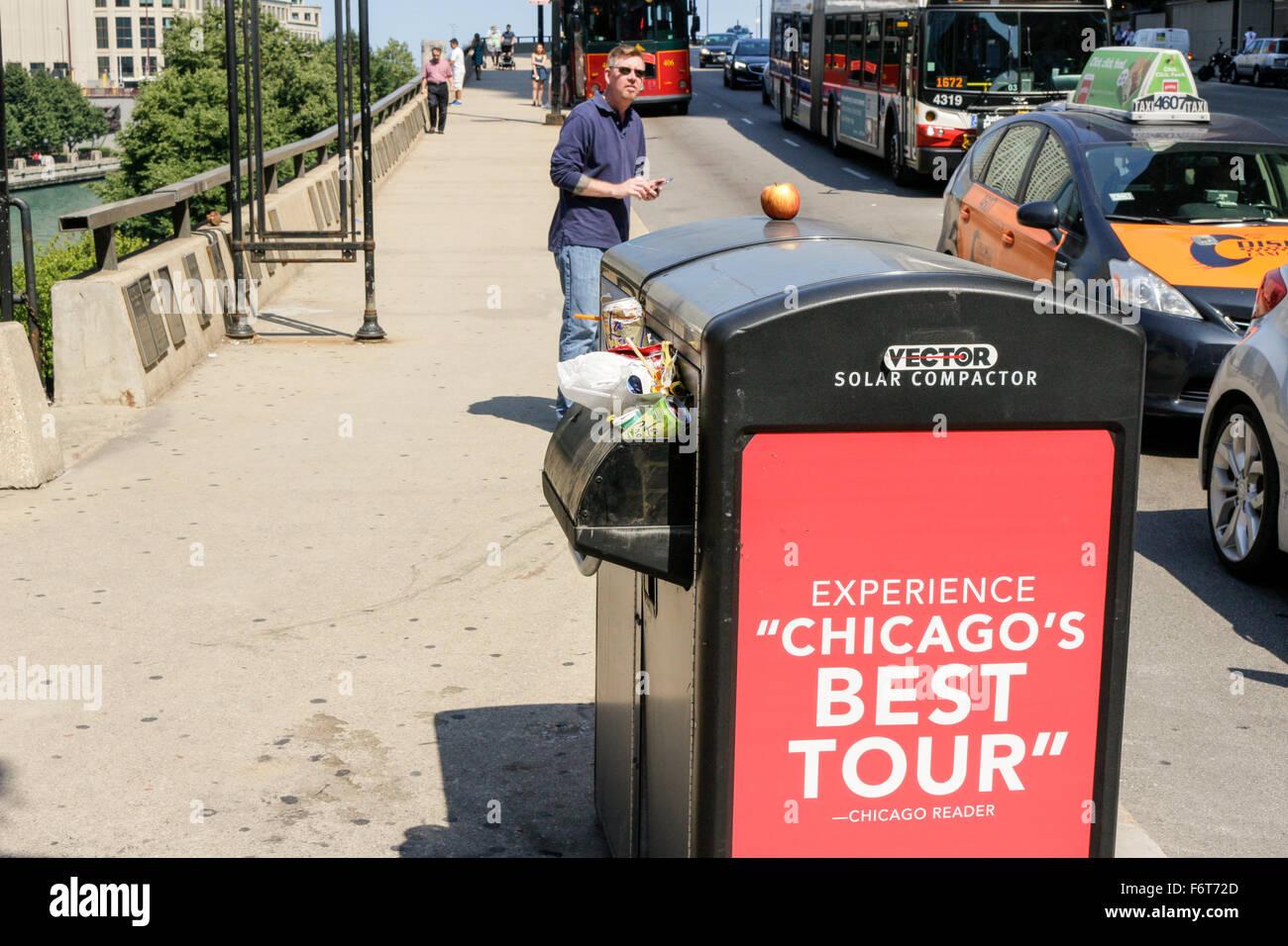 Overflowing trash receptacle, Chicago, Illinois. - Stock Image