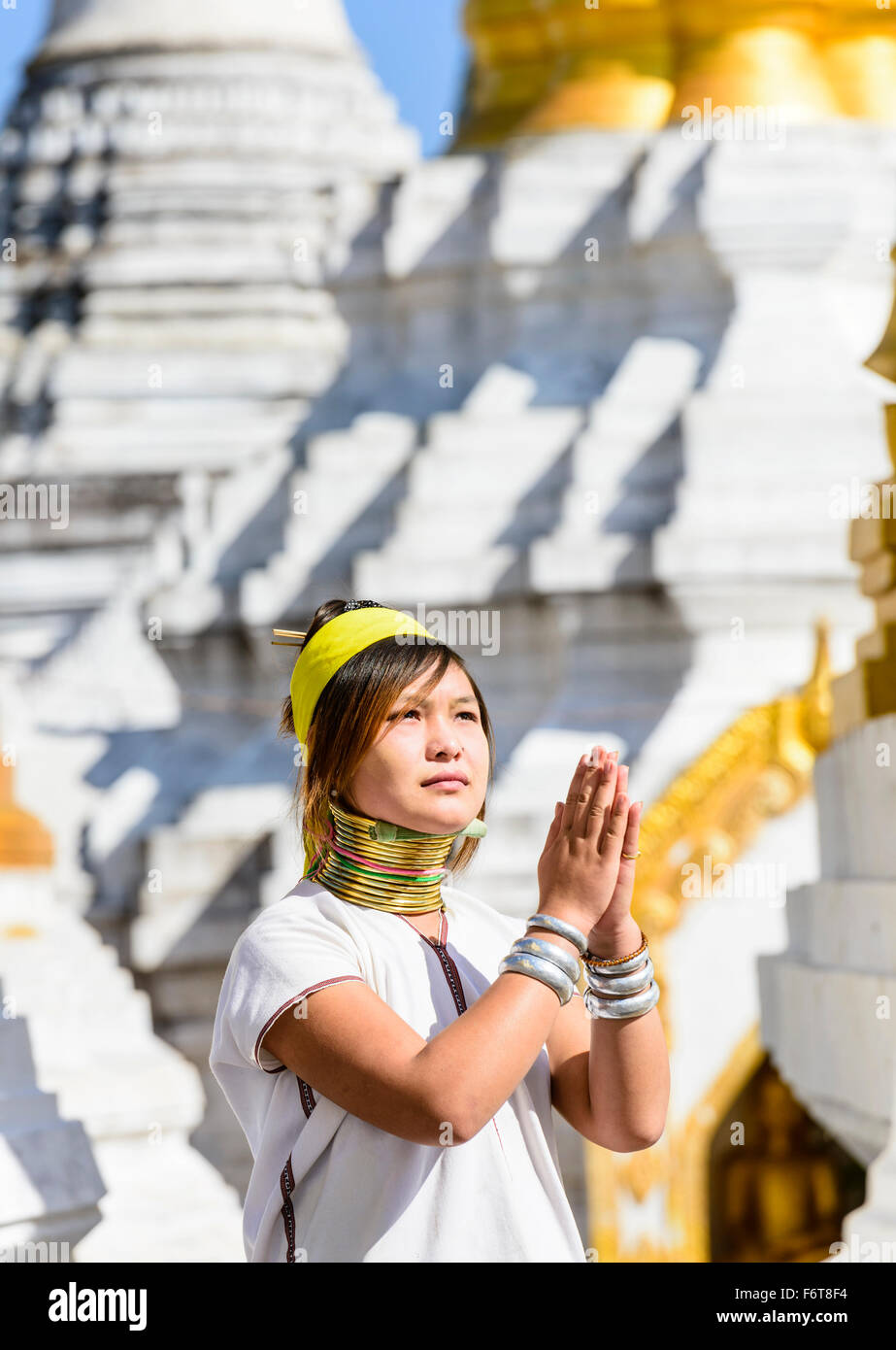 Asian woman doing traditional dance at temple - Stock Image