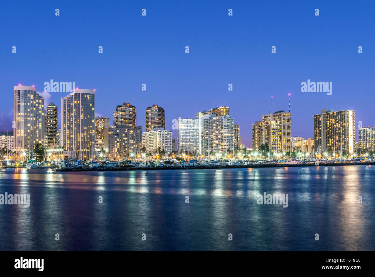Honolulu city skyline reflection in ocean, Hawaii, United States - Stock Image