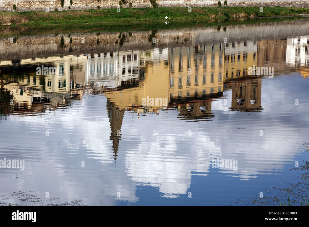 Buildings reflected in the Arno River, Florence, Italy - Stock Image