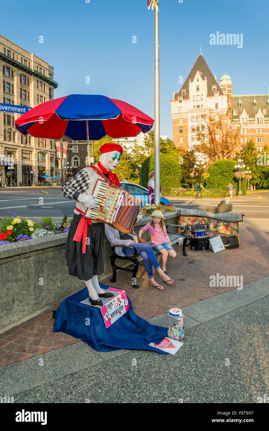 Mime with accordian, busking in Victoria, British Columbia, Canada - Stock Image