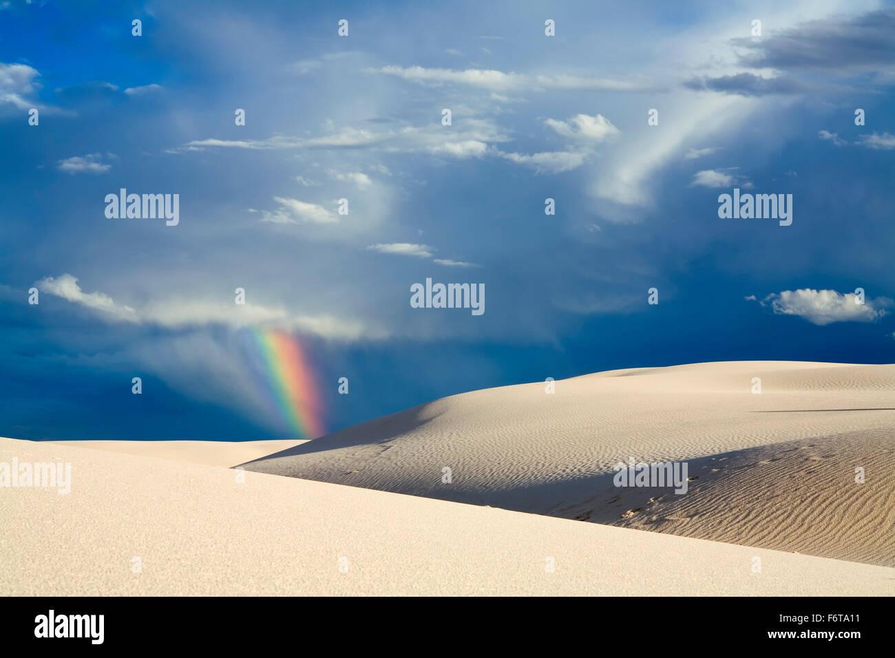 Rainbow over sand dunes, White Sands National Monument, Alamogordo, New Mexico USA - Stock Image