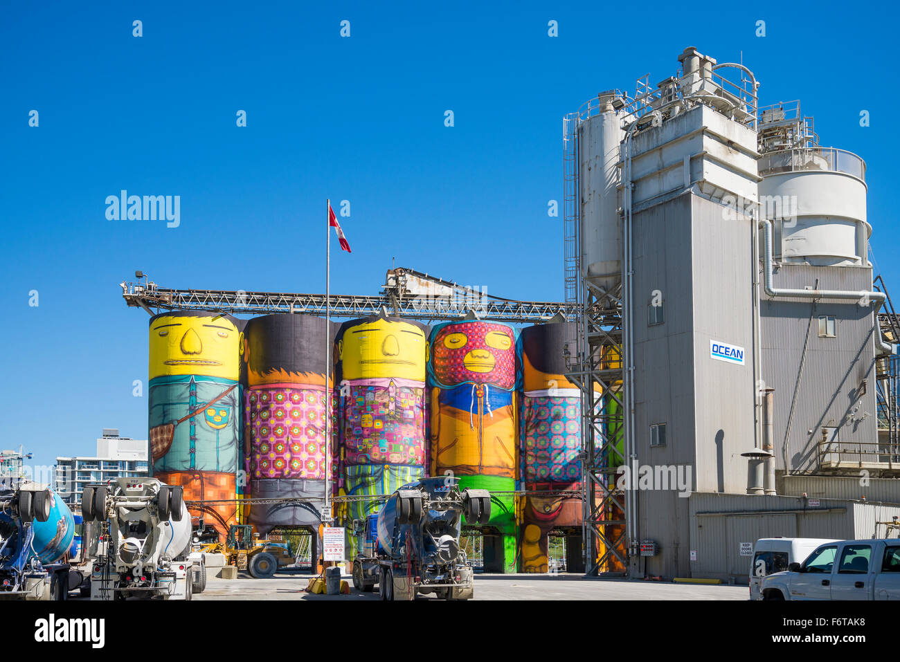 Public Art Mural called Giants on Granville Island's Ocean Cement buildings, Vancouver, British Columbia, Canada - Stock Image