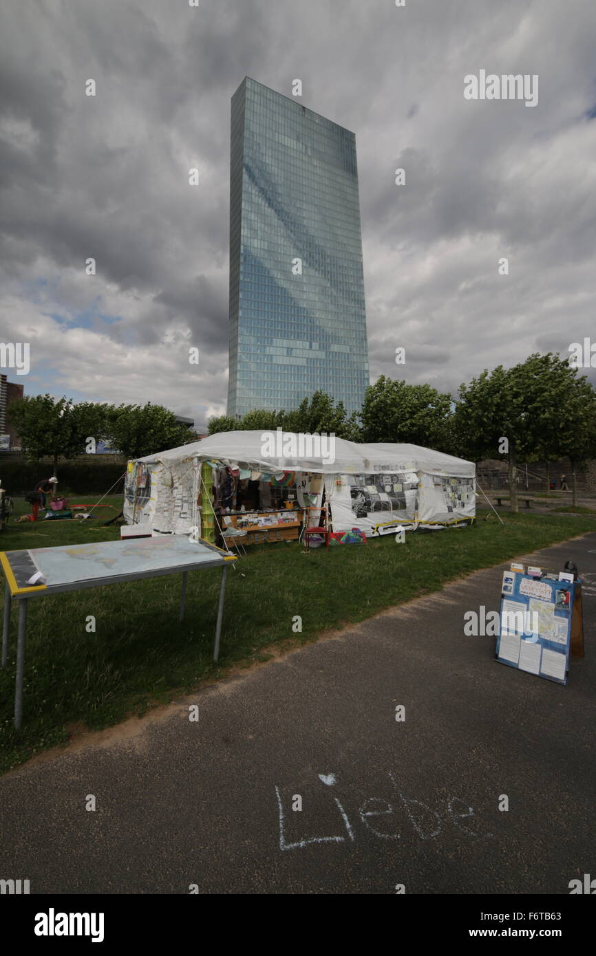 New European Central Bank Building Frankfurt Protestor tent in foreground  Love (Liebe) written with chalk on pavement - Stock Image
