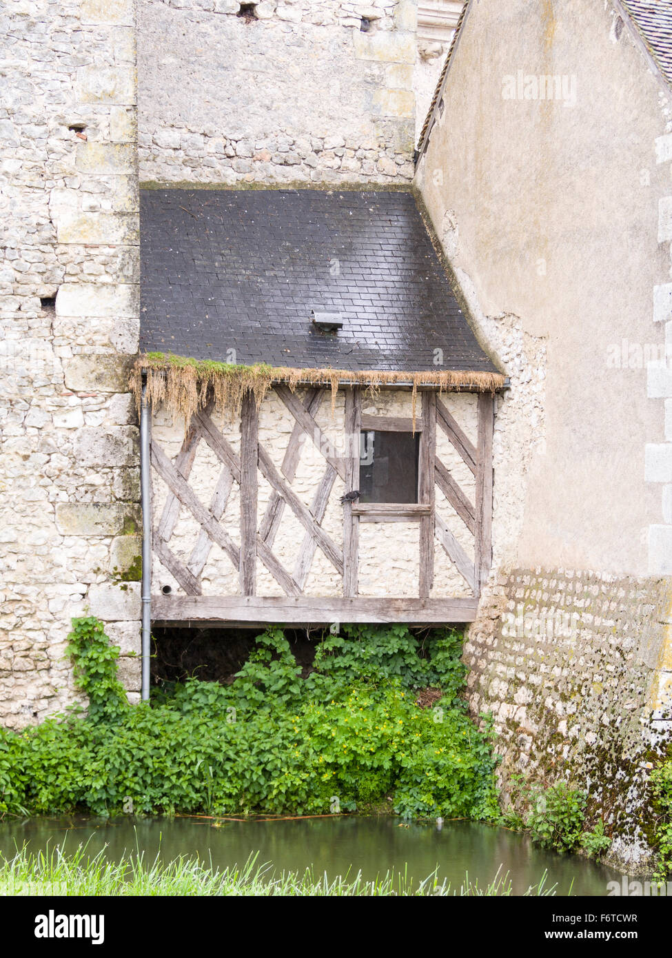 Addition: a small half-timbered room added to the Chateau. A small addition joins two parts of the ancient Chateau. - Stock Image