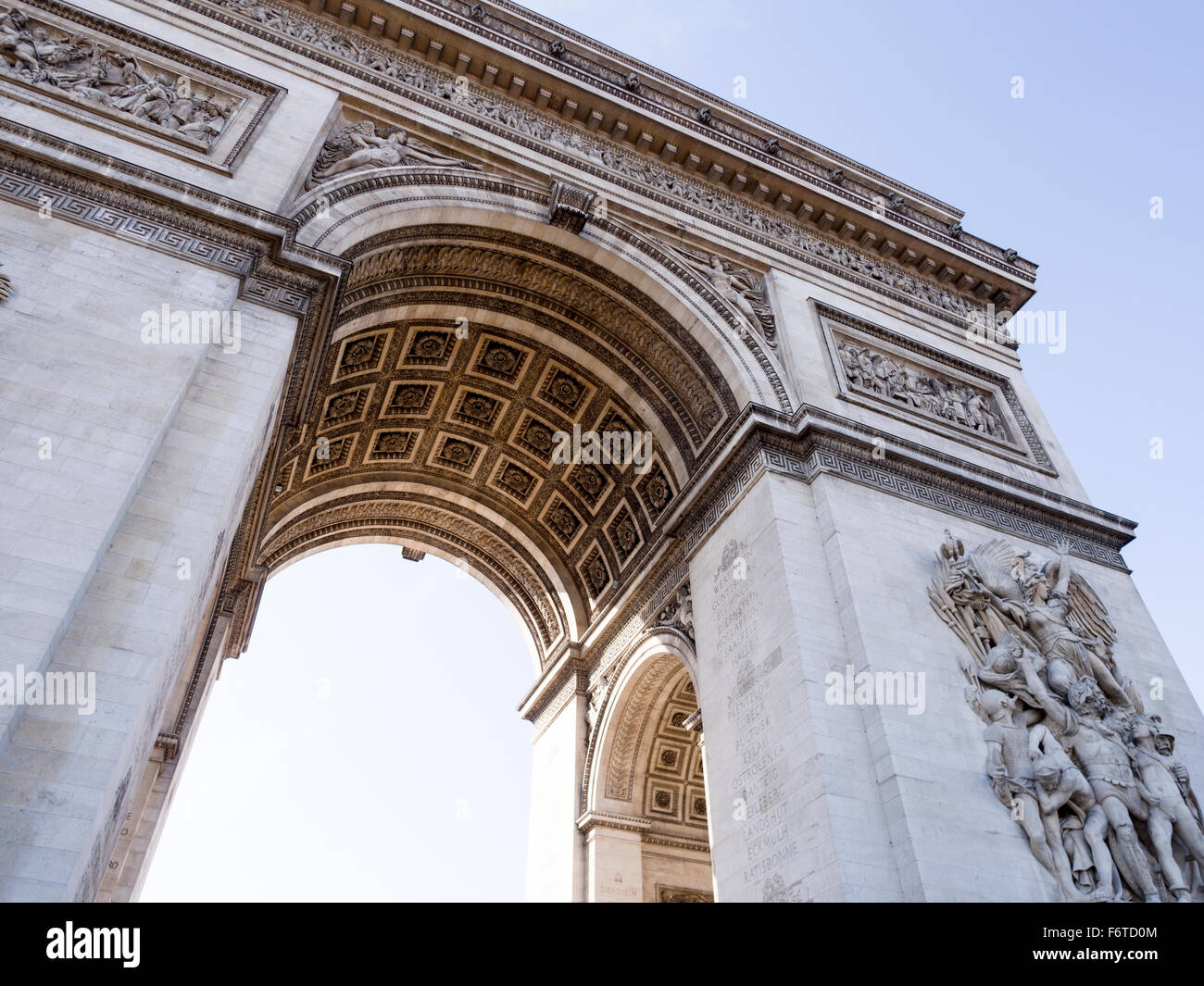 The Arc de Triomphe from below. The view from the traffic island below the great arch. - Stock Image