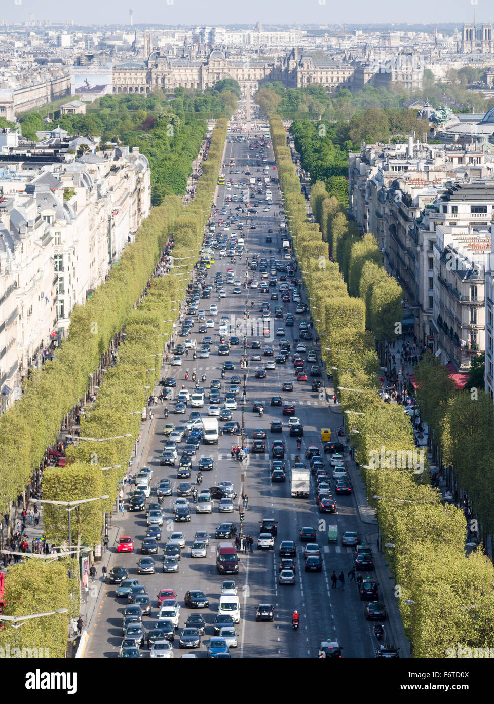 Avenue des Champs-Elysees. The Champs-Elysses from the Arc de Triomphe looking towards the Louvre Palace. - Stock Image