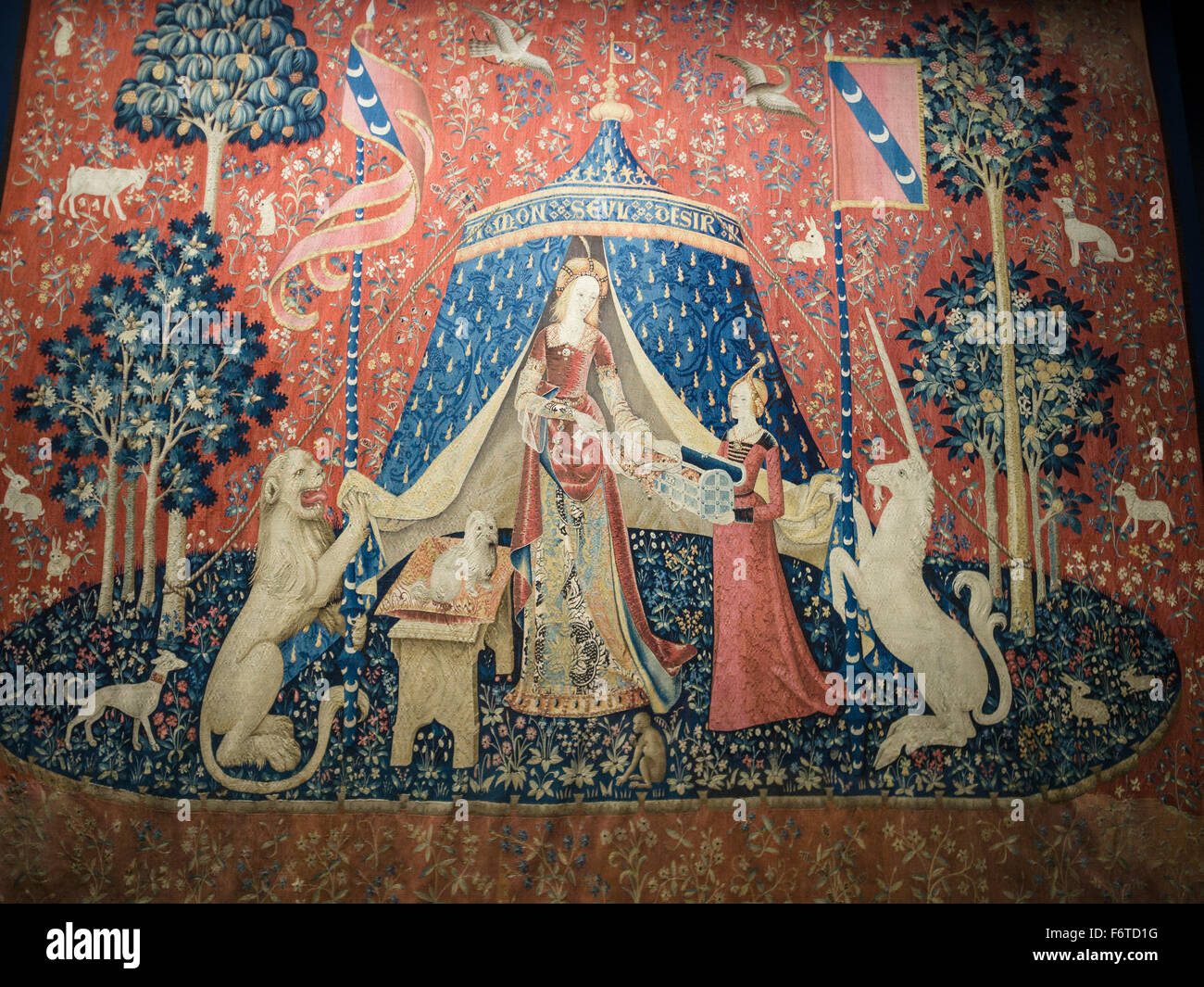 Lady and the Unicorn tapestry: desire. À mon seul désir, my only desire is one of a series of famous woman - Stock Image